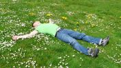 man-sleeping-in-a-field